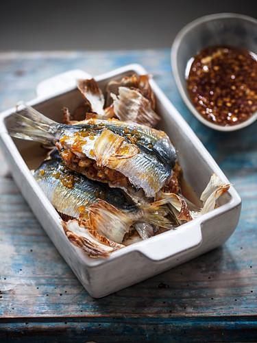 Stuffed sardines with garlic and orange caramel