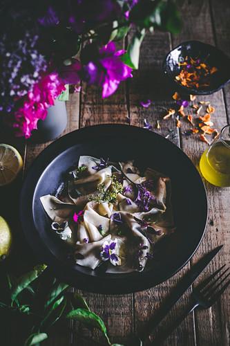 Edible flower pasta with lemon oil