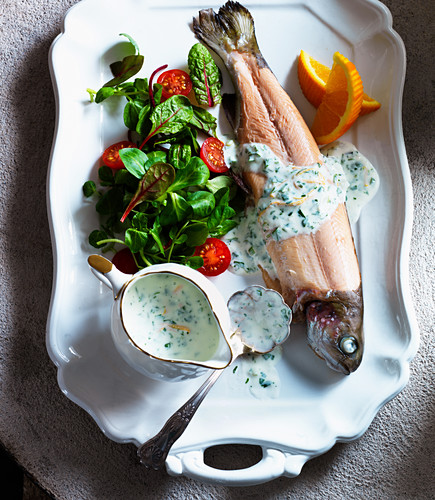 Trout with watercress sauce, salad, cherry tomatoes and oranges