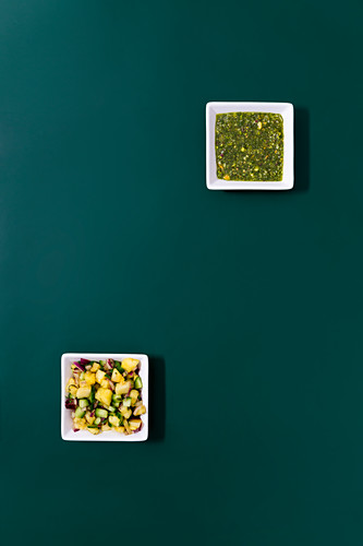A cucumber and pineapple relish and sweet pistachio pesto