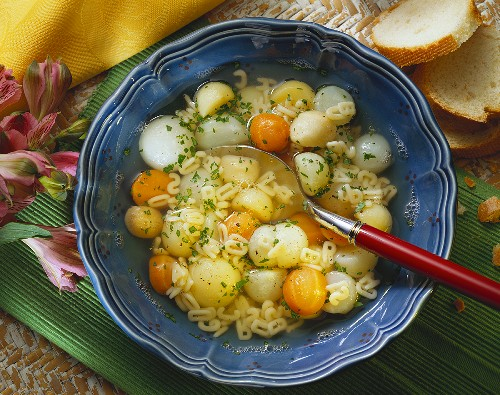 A Bowl Alphabet Soup with Vegetable Balls