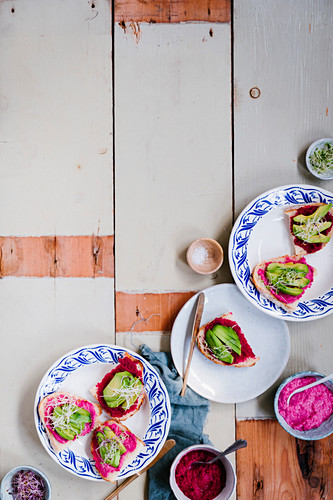 Toast with pink hummus, avocado and vegetable sprouts