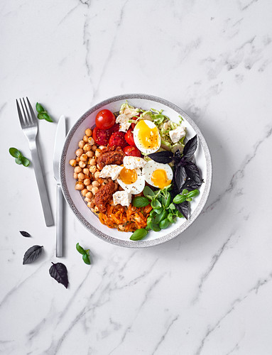 Veggie bowl with chickpeas, boiled eggs and feta cheese