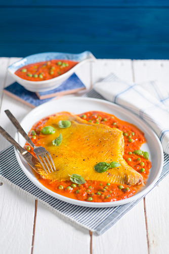 Ray fish wing in a pepper and pea sauce