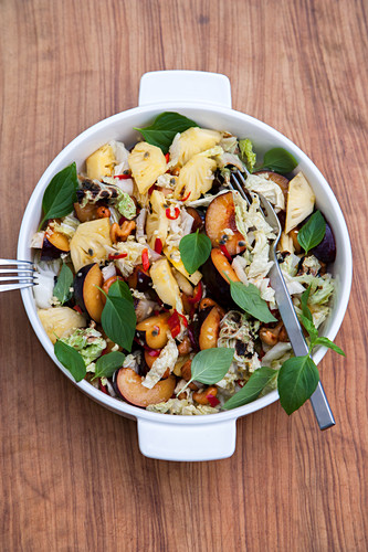 Oriental Chinese cabbage salad with plums and cashew nuts