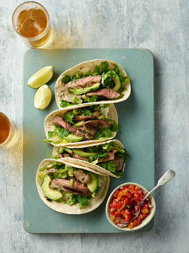 Soft shell tacos with beef and avocado