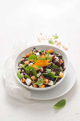 Rice salad with spinach, feta, loquat and mint