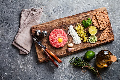 Beef tartare with pickled cucumber and fresh onions