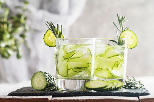 Glasses with fresh organic detox cucumber water