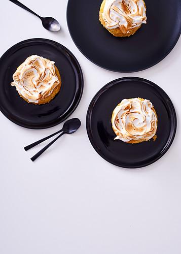 Mini poppyseed polenta cakes topped with italian meringue
