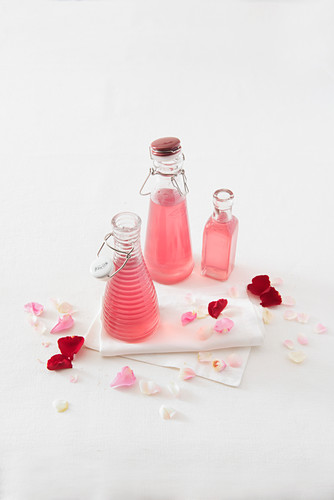 Homemade rose syrup in small bottles