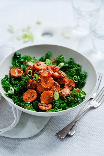 Indian spiced carrots with coriander and caraway on a bed of kale