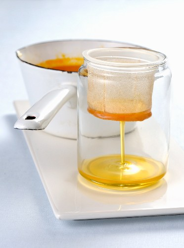 Citrus fruit syrup being sieved