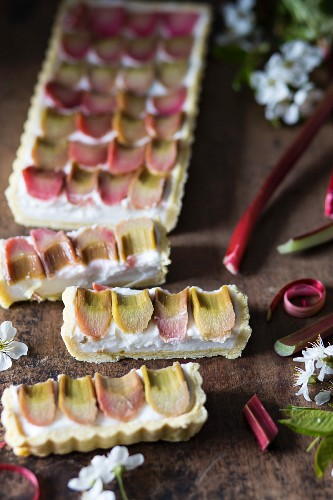 Coconut cream and poached rhubarb tart, sliced