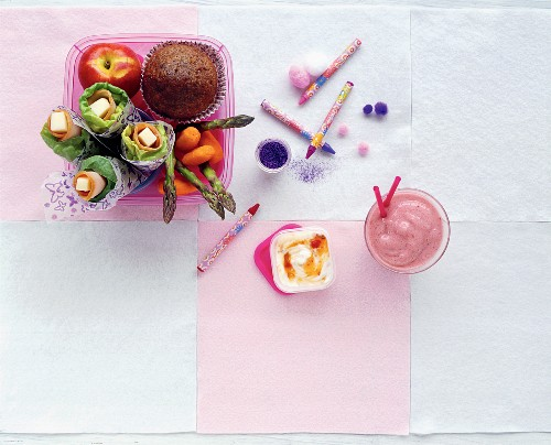 Salad wraps, a banana muffin, smoothie and fruit quark for a school break