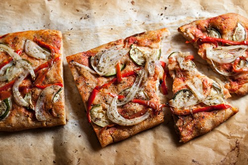Vegetable pizza with onions, peppers and courgette