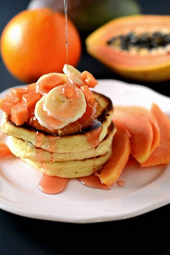 Pancakes with bananas, papaya and syrup