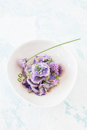 Purple potato salad with chive flowers