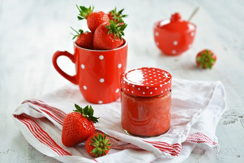 Strawberry mousse in a jam jar on the kitchen table