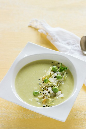 Cream of pea soup with feta cheese and bean sprouts