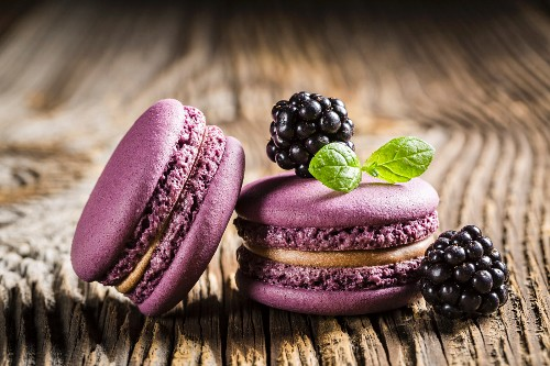 Blackberry macaroons on a wooden table