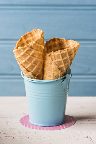 Ice cream cones in a small blue enamel bucket