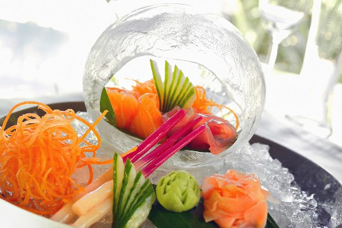 Sashimi on a serving platter and within a decorative ice cube (Japan)