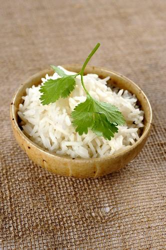 Basmati rice and fresh coriander leaves