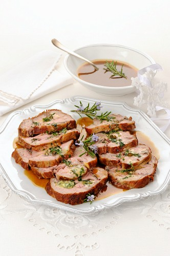 Roast veal wrapped in ham with rosemary