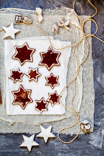 Star shaped almond biscuits filled with redcurrant jelly