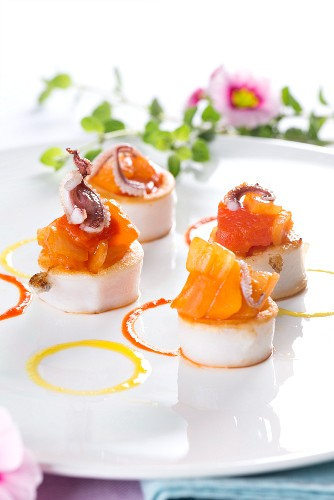 Scallops with salmon and baby octopus