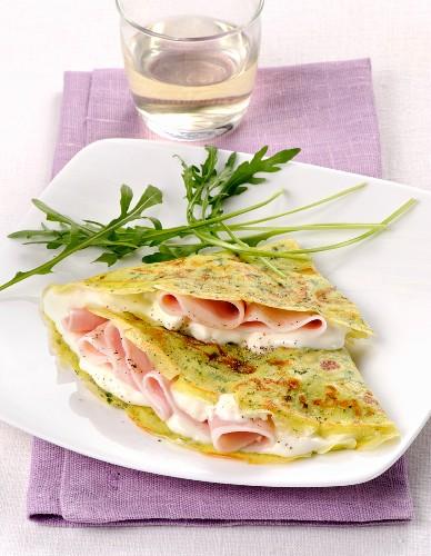 Crespella con rucola, prosciutto e crescenza (rocket pancakes with ham and cheese, Italy)