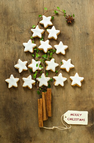 A Christmas tree made from cinnamon stars and cinnamon sticks as Christmas decoration