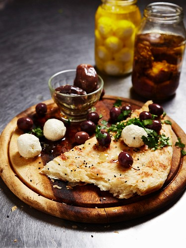 Unleavened bread with preserved olives and cheese balls