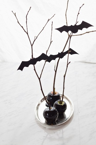 Black candied apples with bats as Halloween decorations