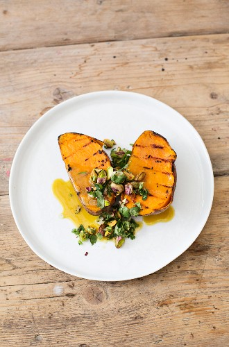 Grilled sweet potatoes with pistachio nuts and coriander