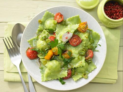 Green ravioli filled with chicken