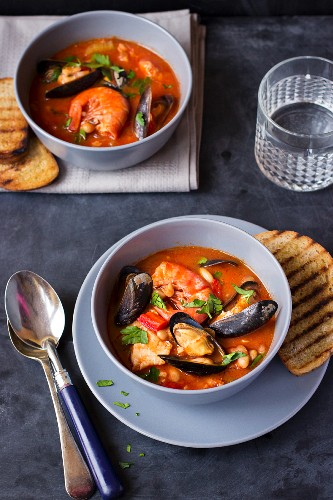 Seafood soup with mussels, prawns and parsley