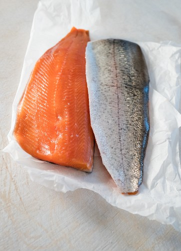 Salmon trout fillets on white paper