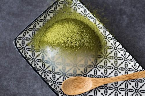A raindrop cake with matcha tea powder (Japan)