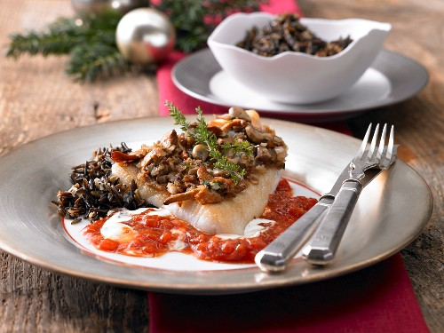 Zander with a mushroom crust on a champagne sauce with wild rice