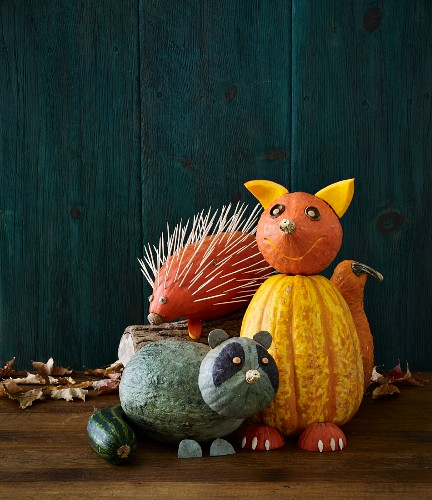 Pumpkin decorations for Halloween: a fox, raccoon and hedgehog