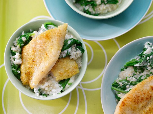 Pearl barley & spinach risotto with a fillet of fish seasoned with curry powder