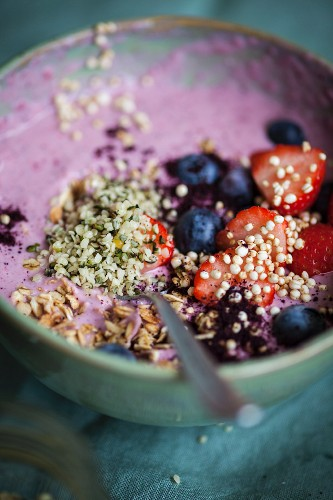 A superfood bowl with strawberries, blueberries, hemp and acai berries