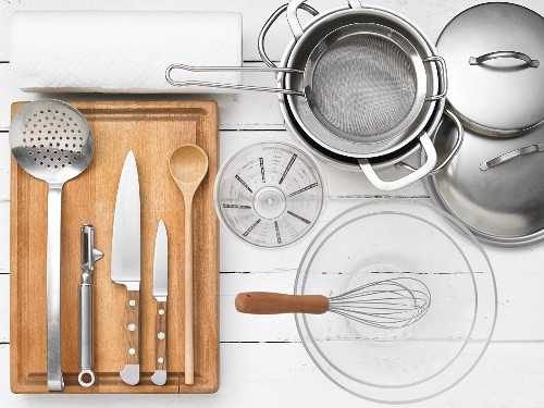 Kitchen utensils for preparing Leipziger Allerlei (a regional German vegetable dish consisting of peas, carrots, asparagus and morel mushrooms) with crab meat