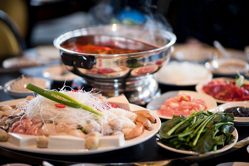 A table full of ingredients for a Chinese fondue (Asia)