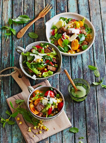 A summery tomato & sweetcorn salad with toasted bread croutons and herbs
