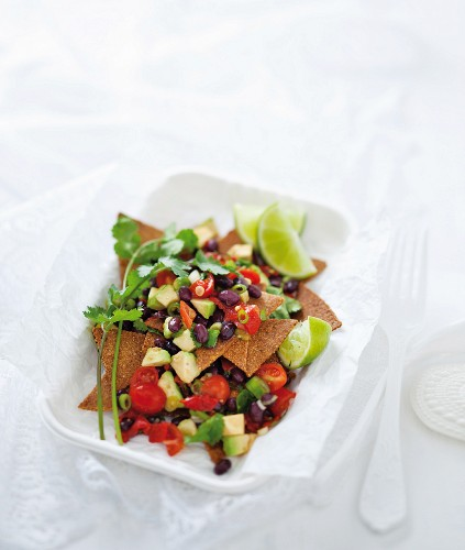 A superfood snack: home-made nachos with bean & avocado salsa
