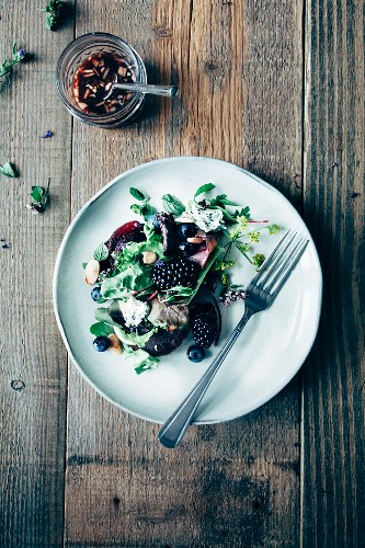 Leaf salad with blueberries, blackberries, beetroot, edible flowers, roasted almonds and red wine vinegar & onion vinaigrette