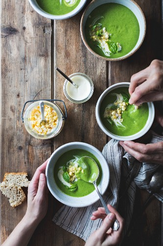 Creamy courgette & basil soup with crème fraîche and sweetcorn